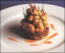 Caracoles y ancas de rana con sofrito de cebolla