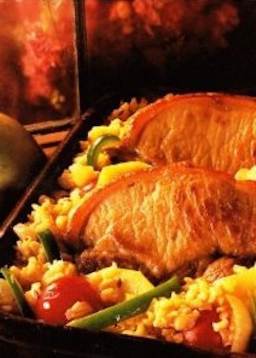 Carne de cerdo con tomate al horno