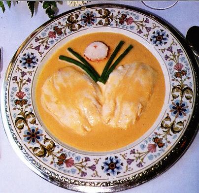 Escalopes de lubina con salsa de bogavante