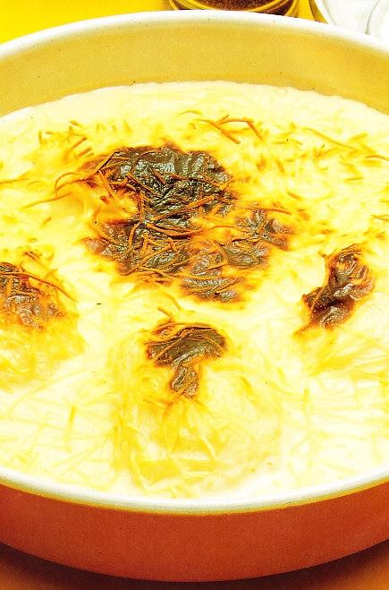 Huevos con salsa Mornay gratinados