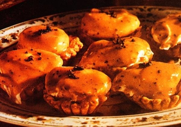 Huevos escalfados con salsa de trufa