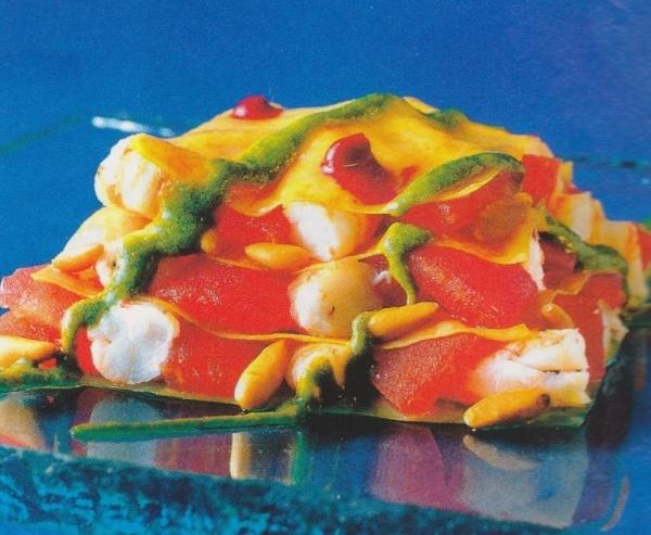 Lasaña de langostinos y tomates al pesto