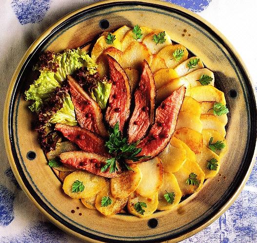 Magret de pato con patatas