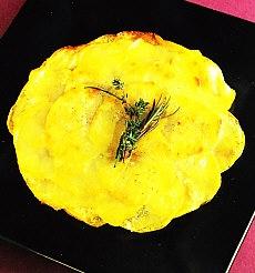 Teglia de patata y setas de calabaza confitadas