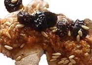 Bistec de avestruz en salsa de pasas