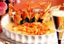 Receta de Cigalas con arroz a la crema de naranja