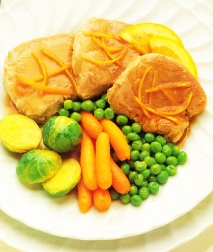 Filetes de cerdo con salsa de naranja