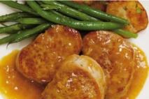 Medallones de solomillo de cerdo con salsa de naranjas