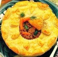 Pastel relleno de carne y verduras