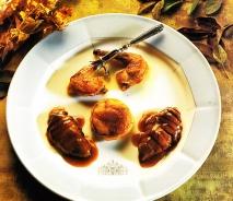 Pechuga de pichón a la miel y su muslo al horno
