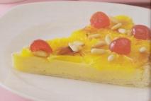 Tarta de naranja y piñones